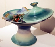 Carol Smeraldo. Receiving: Open #1. 2003. Porcelain bowl on pedestal with lid, marbles. 37 x 36 cm. Wheel thrown, carved, impressed, sprayed, Photo by J. Beveridge .