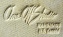 """Carol Smeraldo. 2005 to present, custom made rubber stamp signature on production work: """"One Off Studio (logo), Handmade N.S. Canada"""", forms made by assistants, altered and decorated by Carol."""