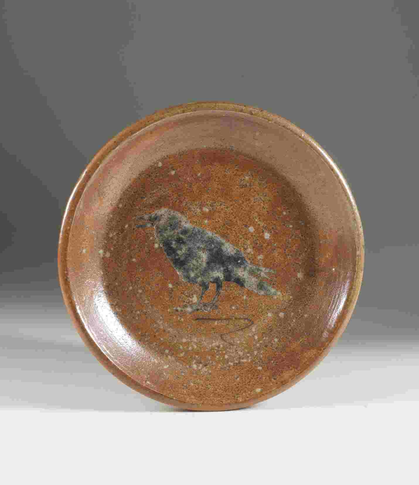 Crow plate, approximately 21 cm in diameter, 2012. Wheel thrown stoneware with stenciled image, wood/soda fired to cone 9-10. Photograph: Barbara Tipton