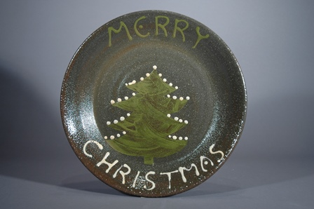 John Chalke and Barbara Tipton. Merry Christmas Plate, not dated. Earthenware, stenciled, trailed slip, handpainted, 27.9 x 5.1 cm. Photo: Barbara Tipton.