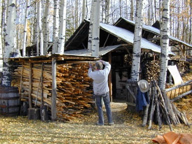 John Chalke. Stacking Wood At The Kiln Shed. Photo: Barbara Tipton.