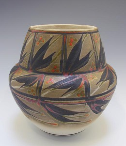 Robin Hopper. Olla Form . Porcelain Sprayed With Terra Sigillata, Burnished & Then Painted With Black/Bronze Pigment Fired To Cone 9 In Oxidation, Then Ttrailed & Brushed With Chrome Red Lead Glaze, Then Fired In Oxidation At Cone 08. Permission of the artist. Photo by Judi Dyelle