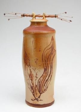 Carol Smeraldo. (DATE?) Raku fired lidded Jar. Wheel thrown, terra sigilatta, burnished, iron fumed. Copper pipe and wire and crystals. 23 x 14 cm