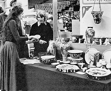 Carol Smeraldo of One Off studio display at a craft market. 1979