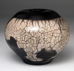 Carol Smeraldo. (DATE??) Black and white naked raku vase. Wheel thrown and burnished. 19 x 23.5 cm.