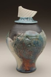 Carol Smeraldo. DATE? Ocean I. Covered (RAKU?) Jar with translucent porcelain fragment on sculptured lid. Carved and stretched. 21.5 x 15.2 cm. Photo: Stephen Hill, Center Street Clay, Chicago.