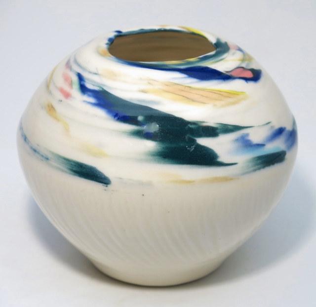 Carol Smeraldo. 2014. Swirl Vase 5. Wheel thrown translucent porcelain. Clear glaze overall. 2230˚F oxidation. 11.4 x 14 cm. porcelain.