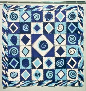 Blue Mandala, 1992. Porcelain, embroidery floss, plexi rod. 64 x 64 cm. Photo:Gary Castle.
