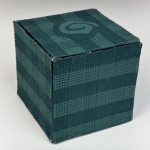 Green Spiral Box, 2009. Porcelain, (wire, beads as connectors) fired to Cone 9 in oxidation. 14X14cm. Photo: Chris Myhr