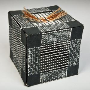Black Box with Raffia, 2009. Porcelain. raffia (wire beads as connectors). 13X13cm. Photo: Chris Myhr