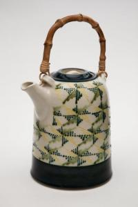 Peacock blue, yellow and green teapot, 1982. White stoneware, underglaze colours, transparent glaze, fired to Cone 5. 14X22.5cm. Photo: Chris Myhr