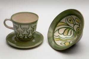 "Copper Green ""Mishima"" Bowl and Cup and Saucer, 1981. White stoneware,underglaze colour, taransparent glaze, fired to Cone 5 7X14cm Bowl, 8X8.5cm cup, 1X12.5cm saucer. Photo: Chris Myrh"