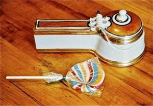 "Campbell ""Lollipop Box,"" 1976. Porcelain, C/10 reduction, C/018 lustered 23 cm long. Courtesy of the artist."