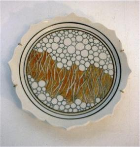 Campbell plate with a tendril design, 1978. Porcelain scalloped edge, press moulded, C/10 reduction, lustres. Courtesy of the artist.