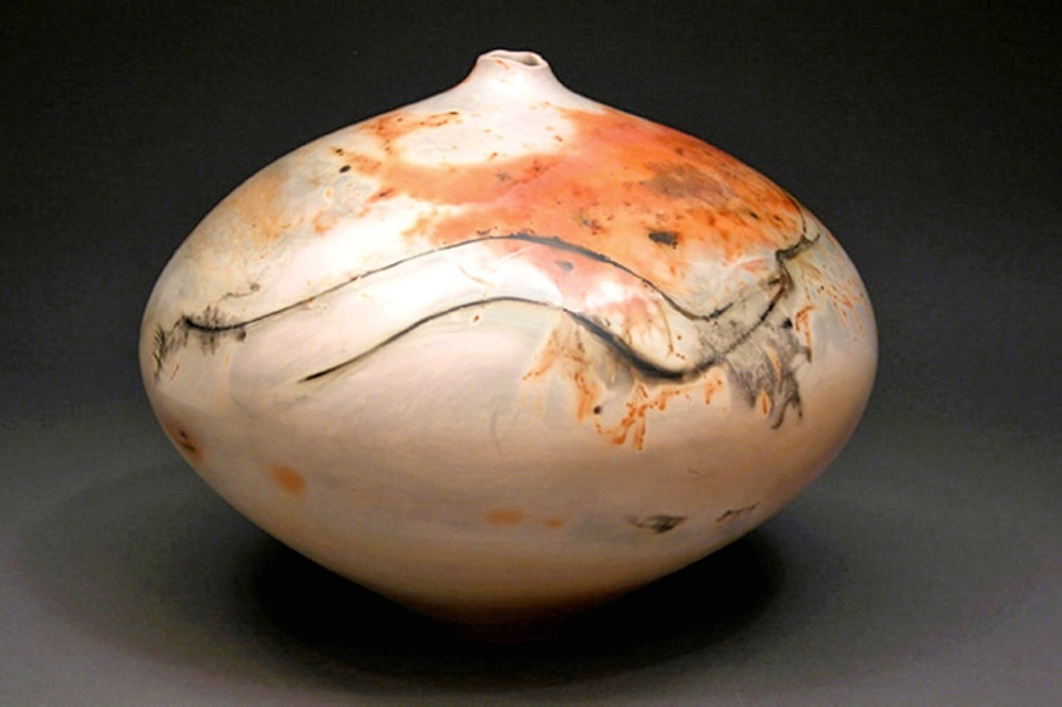 Judy Blake. Saggar fired Vessel, 2005. 30 cm h x 28 cm w. White earthenware. This piece shows the lines from the 'fuming' of the copper wire on the shoulder.