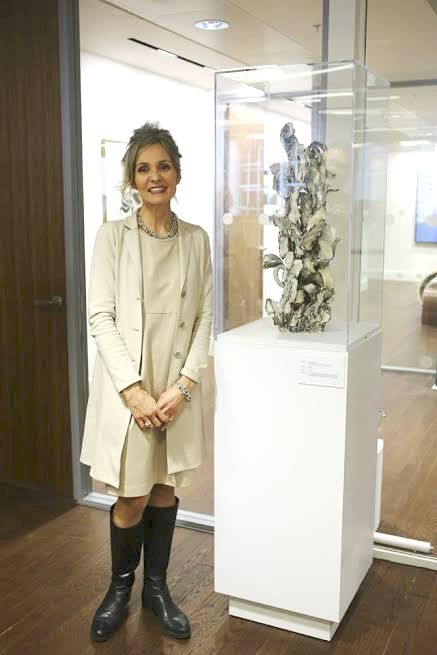 Susan Collett at Canada House next to her work from her Maze Series, Axis ll. approx. 76.2 cm high.