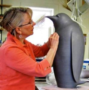 Judy Blake working on a Penguin Sculpture.