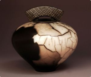 Judy Blake.Naked Raku Lidded Vessel, 2005. white earthenware in sawdust, 24 cm h x 25 cm w.