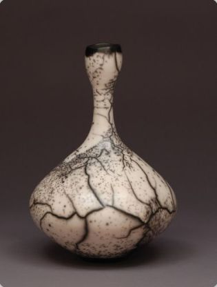 Judy Blake Naked Raku Bottle, 2012. White earthenware in sawdust, 29 cm h x 21.5 cm w.
