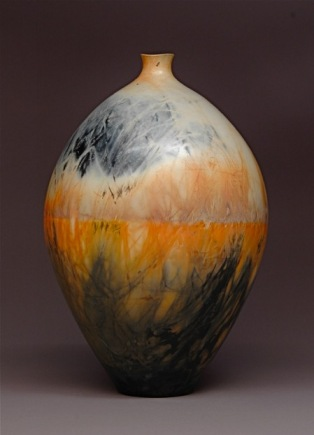 Judy Blake. Saggar-fired vessel, 2012. White earthenware fired with sawdust, shavings , and metallic soaked straw, 40 cm x 27.5 cm.