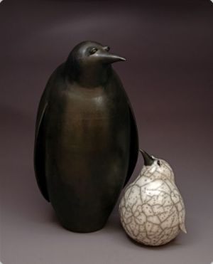Judy Blake. Smoke-fired Penguins. 2013. Adult sawdust-fired, 58 cm h x 33 cm w, and naked raku Chick, 28 cm h x 20 cm w.