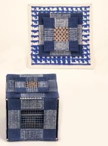 Alexandra McCurdy. The work representing Alexandra at the inductee exhibition. Blue Box with Copper Wire, with an accompanying wall piece. Size of the box is 13X13X13cm; the wallpiece is 19X19X19cm. Porcelain, wire and beads (as connectors) and copper wire. Photo: Steve Farmer.
