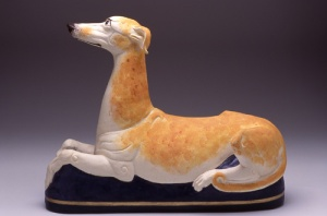 Hound Supersized, 2007. White clay, coloured slips, gersley borate, cone 3., L – 53Cm H - 38cm , Built as a solid form and then hollowed. 2nd International Exhibition for the Silicate Arts, Hungary, ICS Collection, Image in Technical #27 - Dogged Process, and in New Ceramics, Germany, Photo Kenji Nagai