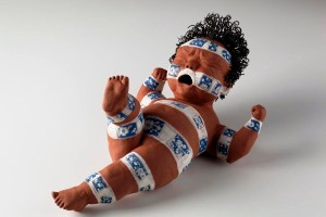 Baby Bound, 2012. Red Clay, bands of white slip, transfers, and wire hair L - 49cm, LARK– Ceramic Sculpture – Making Faces, SOFA-Chicago 2014 catalogue, private collection. Photo Kenji Nagai.