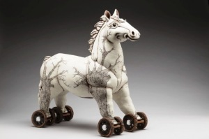 Wheelies in the Woods, 2014. Red Clay, white slips, press moulded, modeled, sgrafitto drawing of trees, red clay wheels - with tin foil, straw for eyelashes. H –56cm, x L– 51cm . 2014 Solo Exhibition - Horsing Around - Gallery of BC Ceramics .Private Collection. Photo Goran Basaric