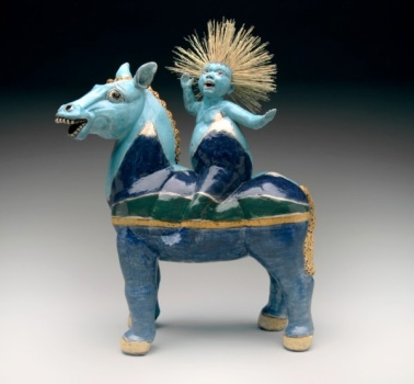 Arriving at the Coast, 2014. Red clay, coloured slips, H – 64cm, x L– 51cm , horse and figure press-moulded with added legs, broom straw for hair. Solo exhibition 2014 - Horsing Around - Gallery of BC Ceramics, 2014 2015 Telling Stories, Chinese Cultural Centre, Vancouver, Artist collection. Photo E.A Clarke