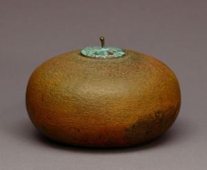 Tom Smith. Small stoneware pot with a bronze lid, nd. 10.2. h x12.7 w cm. Collection Judy Blake.