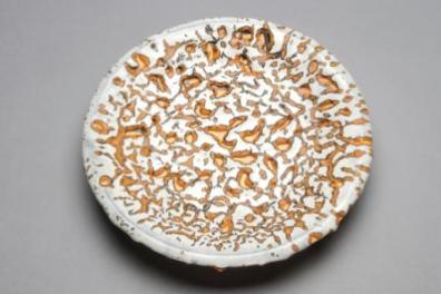 John Chalke. Round White, Orange, Black Mottled Wall Plate. 2000-1. 25.5x25.5x4.5 cm. fired clay and glaze. Collection of the Alberta Foundation for the Arts.