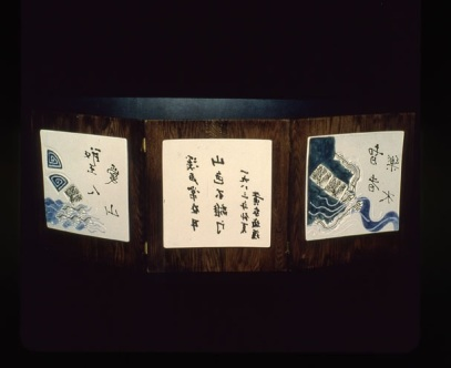 A-M Tremblay. 1982. Le Saint aime la montagne Le sage prise l'eau. Poem by François Houang. Porcelain leaves and wood.book. Each tile is 30.5x30.5x .64 cm, mounted on oak. the Whole thing is 106.7 cm wide. Photo Lucien Lisabelle.
