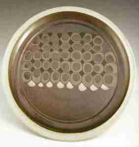 Robin Hopper Dinner Plate 2004. Porcelain with slipware dotting process, thin white glaze over; gas-fired in reduction at cone 10. 30.5 x 2.5 cm.