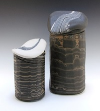 Robin Hopper. Lidded jars, Core Sample series. 1986/7. Facetted, Three- Colored Porcelain Agateware, white, blue and black; glazed inside, unglazed outside. Electric-fired at cone 8. Height of the larger jar is 25.4 cm. Photo: Judi Dyelle.