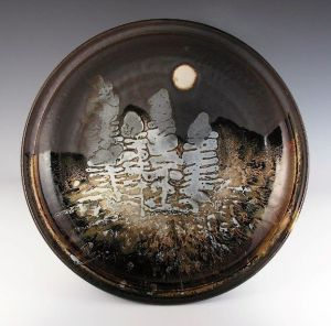 """Robin Hopper. Ghost Forest #1. """"Night Forest Series, Landscape Plate."""" 1978. Porcelain. Multiple glazes with varied application methods: poured, splashed, trailed, glaze intaglio and sprinkled dry materials and dry wood ash. Gas-fired in reduction cone 10. 45.7cm diam. Photo: Judi Dyelle."""