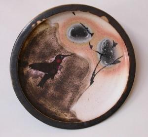 Robin Hopper. Hummingbird Plate #1, 1987. Porcelain with sandblasted image, pigment brushwork, bone fuming, gas, reduction fired cone 9. 30.5 x 5.1 cm. Photo: Judi Dyelle.