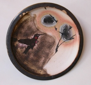 Robin Hopper. Hummingbird Plate #1, 1987. Porcelain with sandblasted image, pigment brushwork, bone fuming, gas, reduction fired cone 9. 30.5 x 5.1 cm. Photo: Judi Dyelle.