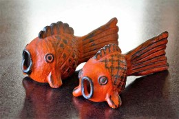 Thomas Kakinuma Red Fish, Large – W24 X H13cm x D8cm, Small – W20cm x H 11cm x 61cm, Red glaze, brushed iron slip, date unknown, Collection of Jasper Sloan Yip and author.
