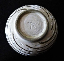 Incised TK mark on trimmed foot of bowl. Courtesy of the author.