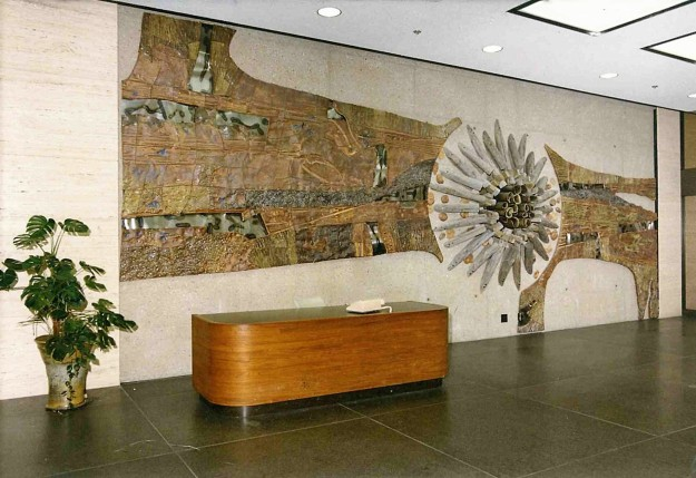 Mural. Alberta Government Telephone, Edmonton Offices. 1971. Stoneware with torch-marked stainless steel and old telegraph poles attached to a raw concrete wall.