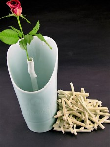 Harlan House. Windy Single Rose Vase With Fries. 2009. Vase form is slip cast with cobalt underglaze drawing and clear HH celadon over. Fries are handbuilt with Imperial Snapdragon Yellow glaze.