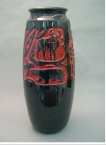 "Jean Cartier. 1970. Red and black ""Skimo"" vase. Musee Marius Barbeau. St. Joseph-de-beauce."