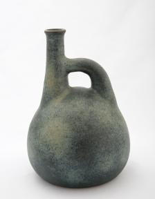 Jan Grove. Jug with Offset Neck, moss green glaze, 1986. 25 x 17 cm. Private collection. Photo: Robert Matheson.