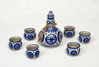 Helga Grove. Saki Set, 1967, white glaze with cobalt blue décor. Bottle and stopper 16.5 x 11 cm; six cups each 4.7 x 5.5 cm. Private collection. Photo: Robert Matheson.
