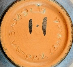 "Jan Grove's incised potter's wheel and Helga Grove's painted ""H"", with ""Victoria Canada""."