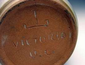 Jan Grove incised mark with potter's wheel and 'Victoria BC'.