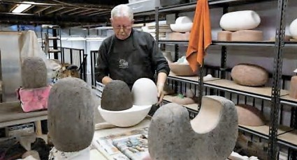 Les Manning in his studio working on Common Opposites. Photo: Alberta Craft Council.