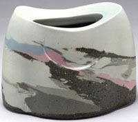 Les Manning. 2007. Sun Up/Sun Down . Laminated stoneware, porcelain with celadon glaze, sandblasted. 18.5 x 25 x 21 cm. Collection: Alberta Foundation for the Arts.