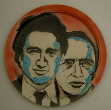 Keith Campbell. 2017. C/6 porcelain plate with photo stencil airbrushed, drawn, brushed, sgrafitto image with a clear glaze 35 cm wide